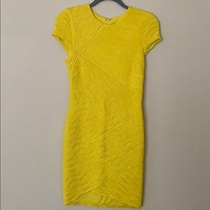Bright yellow, form fitting, Ronny Kobo dress